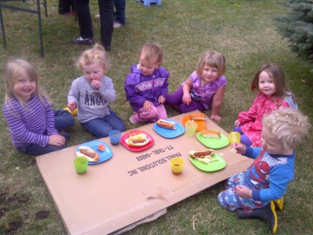 The CFY kids enjoying BBQ at garage sale