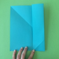3. take the right and left sides of the paper and fold each side to the middle crease