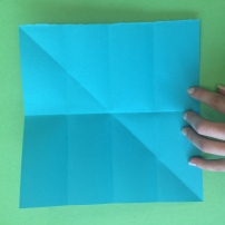 5. Take the top and bottom sides and fold toward the middle crease