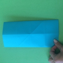 9. When they are folded over, flip over the entire paper